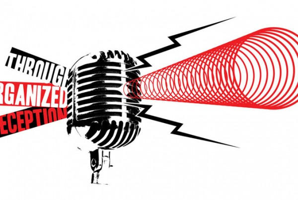 A microphone with the words Through Organized Deception.