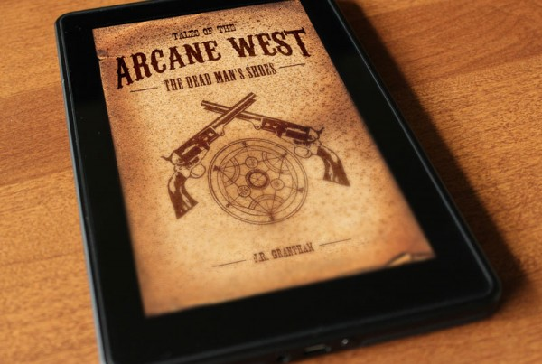 A tablet with the book Arcane West on the screen.